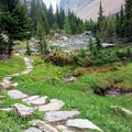 The trail winds through some beautiful alpine meadows.- Lake Oesa