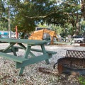 Each site has a picnic table and fire ring.- River's End Campground