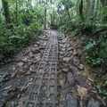Parts of the trail have been stabilized with blocks that prevent slips, but this makes for a rocky trail.- Rio Celeste
