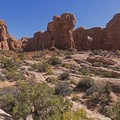 A medium sized arch in the distance.- The Garden of Eden and Owl Rock