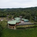 Aerial view of the parking lot and restaurant.- Mistico Arenal Hanging Bridges Park