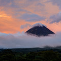 Arenal volcano at sunset, as seen from the Arenal Lake dam.- Mistico Arenal Hanging Bridges Park