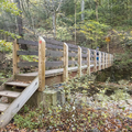 A walking bridge over the Woodland Creek.- Slide, Cornell + Wittenberg Mountains