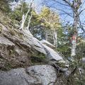 The trail climbs smooth rock faces.- Slide, Cornell + Wittenberg Mountains