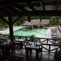 Restaurant and view of one of the pools.- Tabacon Hot Springs