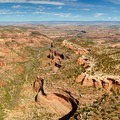 Aerial view of the mesa and arches, and the Colorado River in the distance, looking northwest from near the end of the trail.- Rattlesnake Canyon Arches