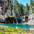 Beautiful turquoise water characterizes the lake.- Hanging Lake