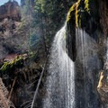The waterfall backlit by the sun. Note that since this picture was taken, some areas of the lake and around the waterfall have been closed off, so please respect all regulations.- Hanging Lake