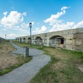 A pathway through the remains of Fort Preble.- Spring Point Ledge Lighthouse