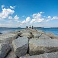 Over 50,000 tons of granite make up the breakwater.- Spring Point Ledge Lighthouse