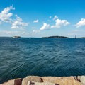 Views north to Fort Gorges and Little Diamond Island.- Spring Point Ledge Lighthouse