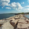 Looking back south at the breakwater and the Fort Preble remains.- Spring Point Ledge Lighthouse