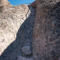 The High Peaks Trail has several sections with handrails and narrow, carved stone steps.- High Peaks Climbing