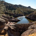 The Monolith sits near the Bear Gulch Reservoir in Pinnacles National Park.- The Monolith