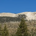 The back side of Mammoth Mountain Ski Area is visible from the trail.- Rainbow Falls Upper and Lower