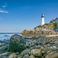 Looking south to the Portland Head Light from a the rocky shore at low tide.- Portland Head Lighthouse
