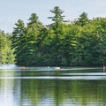 Kayakers paddling near the campground.- Pawtuckaway State Park Campground