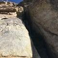The beginning of West Face (5.7) on the Obelisk.- The Obelisk