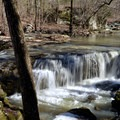 A beautiful unnamed waterfall along the creek to the falls.- Big Creek Cave Falls