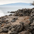 Maui is visible in the distance from Lapakahi State Park.- Lapakahi State Historical Park
