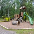 Playground in the campground an day use area.- Liard River Hot Springs Campground