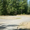 Roundabout. Continue across to the gravel road.- Icy Creek Spring in the Green River Gorge