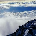 Two climbers ascending the West Buttress just past Washburn's Thumb.- Denali: West Butress