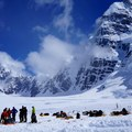 Climbers waiting for their ride at the air strip at Denali Base Camp in the shadow of Mount Hunter.- Denali: West Butress