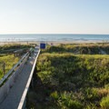 One of several public beach access points from city streets.- Folly Beach + Pier
