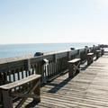Fishing benches on Folly Beach Pier.- Folly Beach + Pier