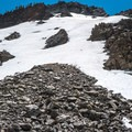 A mix of snow and scree surrounds the upper elevations.- Duck Pass via Wood Lakes + Duck Pass Trail