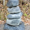 "The ""cairn of thanks"" stacked next to the trail. - Pend d'Oreille Bay Trail"