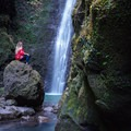 Taking in the majestic Punalau Falls.- Punalau Falls