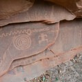 The snake and spiral symbols are thought to represent passage of time and the sun.- Zion's Petroglyph Canyon