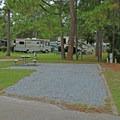 Gravel RV campsite.- Topsail Hill Preserve State Park