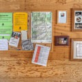 Maps, notes on the history of the hut, a bulletin board and a guest book hang on the walls.- Bradley Hut