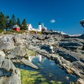 Reflection of the lighthouse and out buildings in the tide pools.- Pemaquid Lighthouse