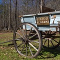 An old wagon greets visitors to the 1,500-acre Tannehill Ironworks Historical State Park. - Tannehill Ironworks Historical State Park