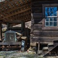 The park showcases a variety of historic cabins. - Tannehill Ironworks Historical State Park