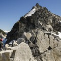 The ridge leading to the summit is an exposed scramble.- Cypress Peak