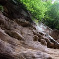 Petroglyphs and ancient writing dot the cave walls. - Indian Cave State Park