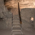 A staircase assists visitors in climbing over the fragile walls of the ruins.- Gila Cliff Dwellings National Monument
