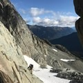 Scrambling up the short rock face to avoid getting onto the glacier.- Joffre Peak: Northeast Ridge Scramble