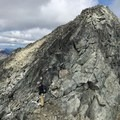 Crossing to the real summit. - Joffre Peak: Northeast Ridge Scramble