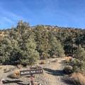 The trailhead is well marked immediately below the unmissable Charcoal Kilns.- Wildrose Peak
