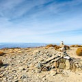 Progress past the false peak for another quarter-mile until you reach the peak, marked by a single large cairn.- Wildrose Peak