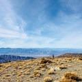 Looking west with the peaks of the Sierra visible on the horizon.- Wildrose Peak