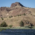 Dramatic basalt formations along the banks of the John Day River.- John Day River: Service Creek to Clarno