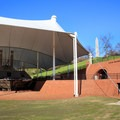 A must-see, the USS Cairo Museum details the crucial role the Navy played during the siege of Vicksburg. The Navy memorial is in the background. Under the tent is the ironclad boat, Cairo.- Vicksburg National Military Park