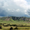 Storm clouds approach from behind Crown Rock.- Scottsbluff National Monument